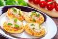 Vegetarian mini pizzas homemade served on a wooden board Stock Photos