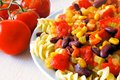 Vegetarian pasta with tomatoes dish beans and assorted vegetables Royalty Free Stock Photo
