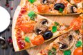 Vegetarian pizza with cherry tomatoes mushroom and olives Stock Photos