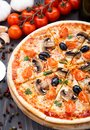 Vegetarian pizza with cherry tomatoes mushroom and olives Royalty Free Stock Photos