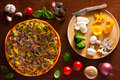 Vegetarian pizza and ingredients Stock Images