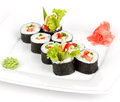 Vegetarian roll with cucumber and pepper on a plate on a white background Royalty Free Stock Photography