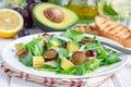 Vegetarian salad with avocado, grape, rucola, onion, vinegar dressing Royalty Free Stock Photo