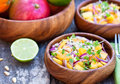 Vegetarian salad with mango oranges and red onion on the wooden Royalty Free Stock Photo