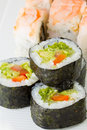 Vegetarian and shrimp sushi roll on white plate Royalty Free Stock Photo