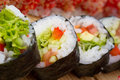 Vegetarian sushi roll with made dish on background Royalty Free Stock Image