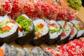 Vegetarian sushi roll with made dish on background Royalty Free Stock Images
