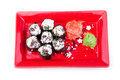 Vegetarian sushi roll served in a form of flower on a red plate on white Stock Photo