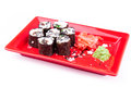 Vegetarian sushi roll served in a form of flower on a red plate on white Royalty Free Stock Image