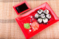 Vegetarian sushi roll served on a red plate in form of flower bamboo mat Royalty Free Stock Photography