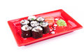 Vegetarian sushi roll served on a red plate in form of flower white Royalty Free Stock Images