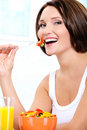 Vegetarian woman  eats useful vegetable food Royalty Free Stock Images