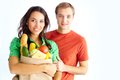 Vegetarians happy couple of healthy eating followers looking at camera Royalty Free Stock Photos