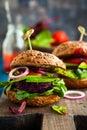Veggie beet and quinoa burger with avocado Stock Photos