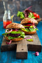 Veggie beet and quinoa burger with avocado Royalty Free Stock Images