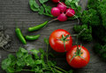 Veggie close up view of nice fresh vegetables on wooden back Royalty Free Stock Photography