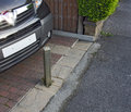 Vehicle security post a in a garden in the locked up position to deter thieves Royalty Free Stock Image
