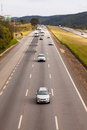 Vehicles on BR-374 highway with headlights on during the daylight obeying the new Brazilian transit laws Royalty Free Stock Photo