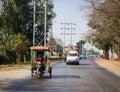 Vehicles run on street in Mandalay, Myanmar