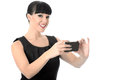 Vein relaxed happy woman taking a self portrait on cell phone with black hair and hispanic or european features looking at camera Stock Photos