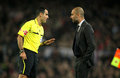 Velasco Carballo talks with Pep Guardiola Stock Image