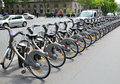 Velib station in paris this is with its distinctive grey bicycles is a large scale public bicycle sharing system Royalty Free Stock Photography