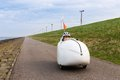Velomobile bicycle along dutch coast ridig Stock Photo