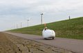 Velomobile bicycle along dutch coast riding Royalty Free Stock Image
