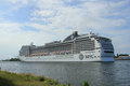 Velsen the netherlands july th msc magnifica on north sea canal from amsterdam towards ijmuiden locks is Royalty Free Stock Photos