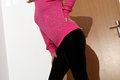 Velvet trousers girl wearing black and a pink blouse Stock Photo