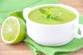 Velvety cream soup gentle green peas mint lime green towel Royalty Free Stock Photos