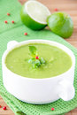 Velvety cream soup gentle green peas mint lime green towel Stock Photography