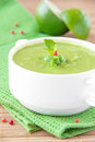 Velvety cream soup gentle green peas mint lime green towel Royalty Free Stock Photography