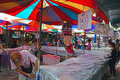 Vendor covering their merchandise as rain started to fall stall with plastic cover during the rainy season in chatuchak weekend Royalty Free Stock Image
