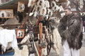 Vendor in fur coat with street bazar at a carnival Royalty Free Stock Images