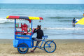 Vendor on olon beach ecuador february selling shaved ice the in ecuador during carnival february Royalty Free Stock Images