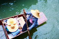 Vendor on traditional floating market in Thailand Stock Photos
