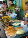 Vendors on the amazon selling regional cuisine off river Stock Image
