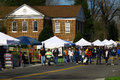 Vendors and pedestrians gloucester virginia april main st in the daffodil parade route on april in gloucester virginia in its th Stock Photo