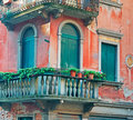 Venetian balcony typical in a colorful building Stock Image