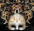 Venetian baroque mask beautiful and elegant with a rich decor on black background Stock Photography