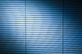 Venetian blinds at night closed or shutters lit by a blue spotlight Stock Photos