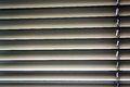 Venetian blinds for shade at the window to protect against heat and sun are attached to a Stock Photos