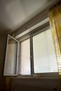 Venetian blinds for shade at the window to protect against heat and sun are attached to a Royalty Free Stock Photos