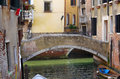 Venetian canal one of beautiful medieval canals attracting thousands tourists from all over the world Royalty Free Stock Photo