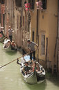 Venetian canal trip tourists on a gondola ride in venice Stock Photography