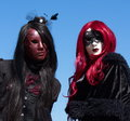 Venetian carnival at annecy france black gothic female couple the Royalty Free Stock Photo