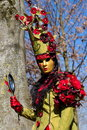 Venetian carnival at annecy france red and green person holding a mirror the of Stock Images