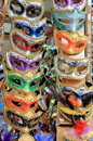 Venetian carnival masks rows of Royalty Free Stock Image