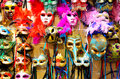 Venetian carnival masks souvenir colored on the wall in the shop Stock Image
